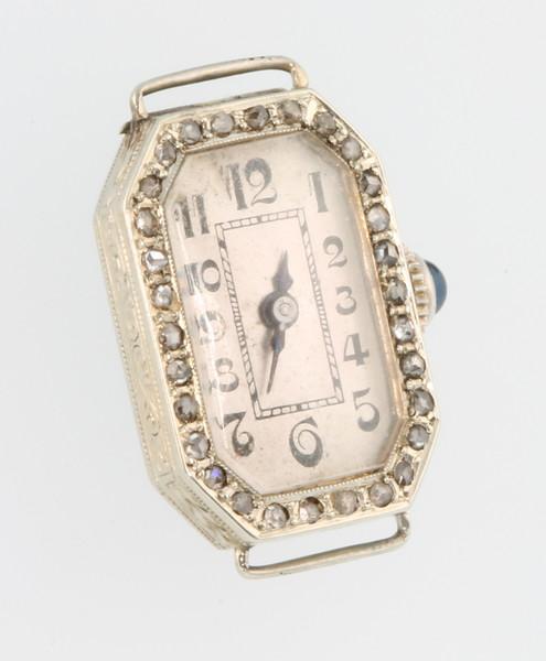 A lady's Art Deco platinum and gold diamond set octagonal wristwatch with sapphire set winder