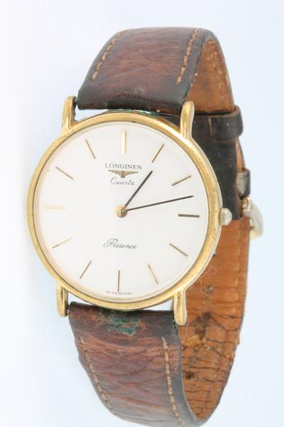 A gentleman's gilt cased Longines quartz Presence wristwatch on a leather strap