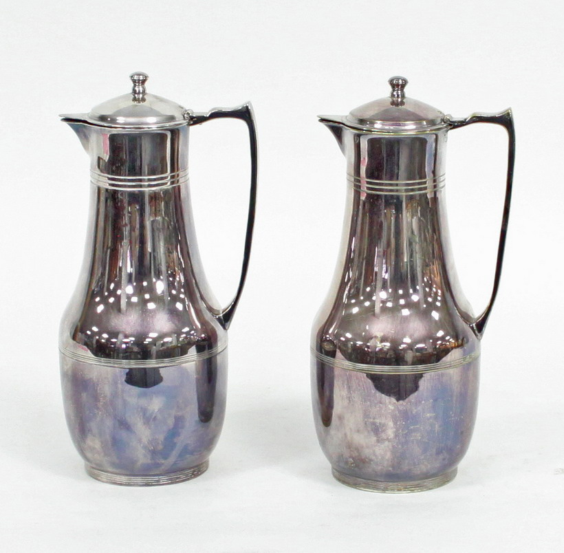 A pair of plated Thermos jugs with hinged covers