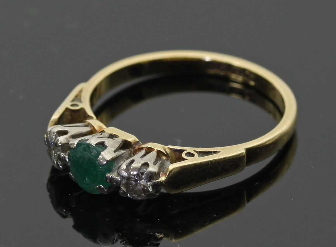 An emerald and diamond 18ct gold ring