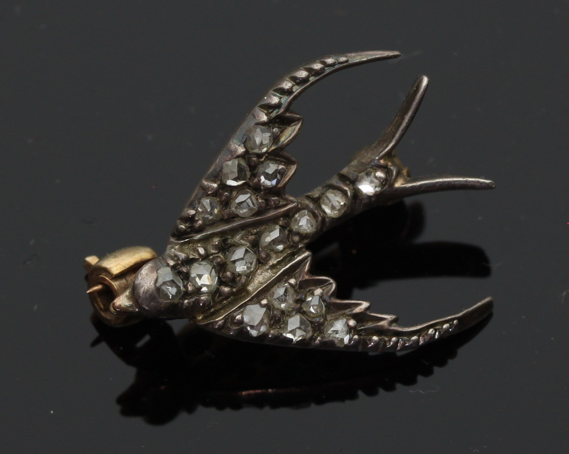 A small diamond set brooch of swallow form