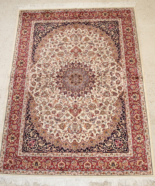 A contemporary Belgian cotton Kashan style white ground carpet with central medallion