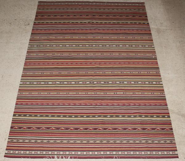 A Kilim rug with multicoloured stripes