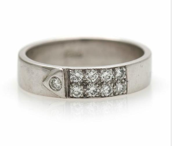 A diamond ring set with nine brilliant-cut diamonds, mounted in 14k white gold