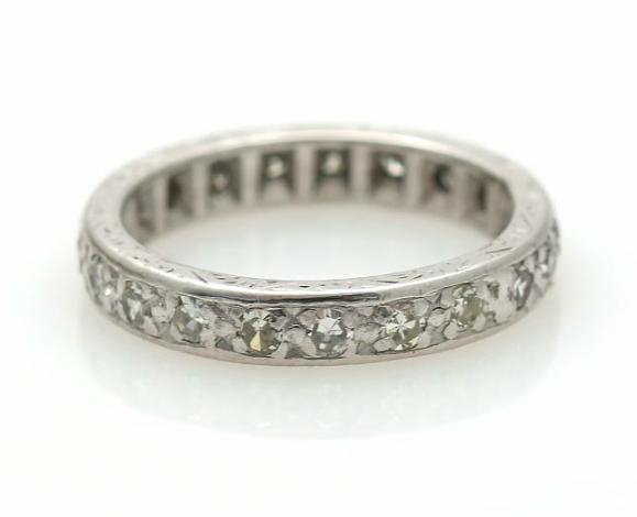 An eternity ring set with numerous single-cut diamonds, mounted in 18k white gold