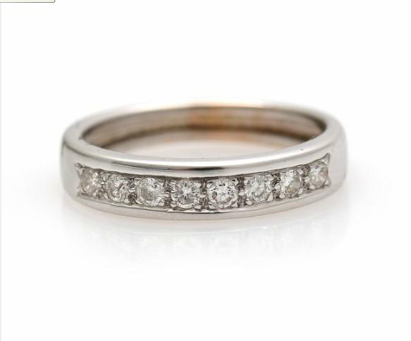 A diamond ring set with eight brilliant-cut diamonds, mounted in 14k white gold