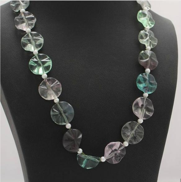 A flourite necklace set with cultured fresh water pearls and flourite with clasp of metal