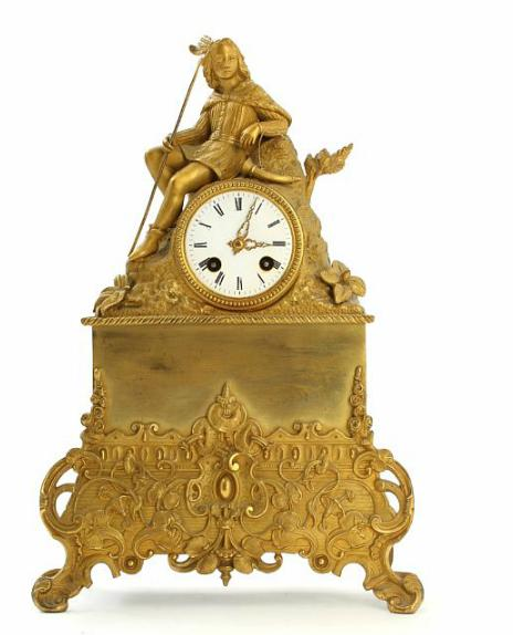 A French 19th century gilded bronze mantle clock, decorated with seated hunter, white enameled dial