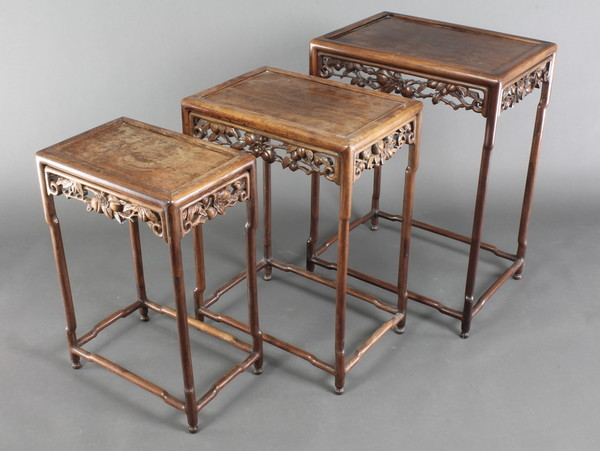 A nest of 3 Chinese hardwood rectangular interfitting coffee tables