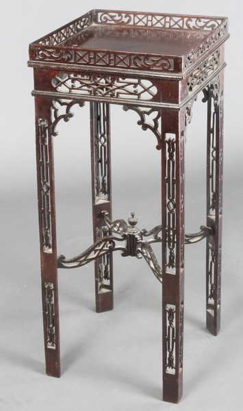 A 19th Century Chippendale style urn table with fret work decoration and X framed stretcher