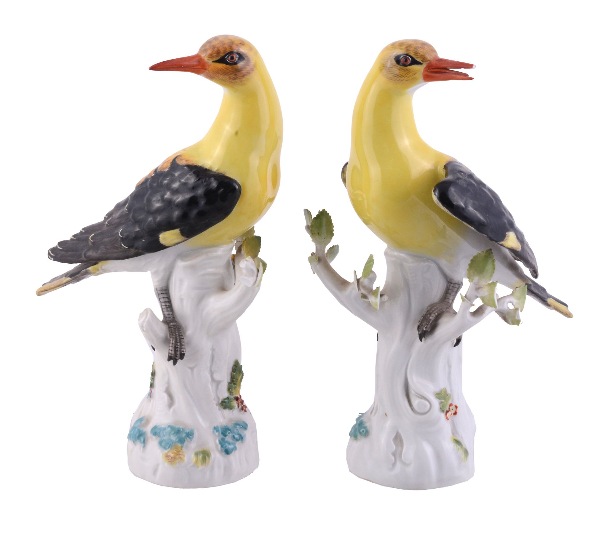 A pair of Meissen models of golden orioles, 20th century, blue crossed marks