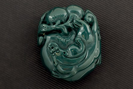 Piece of green jasper carved with dragon and fruits. Weight 284 cts