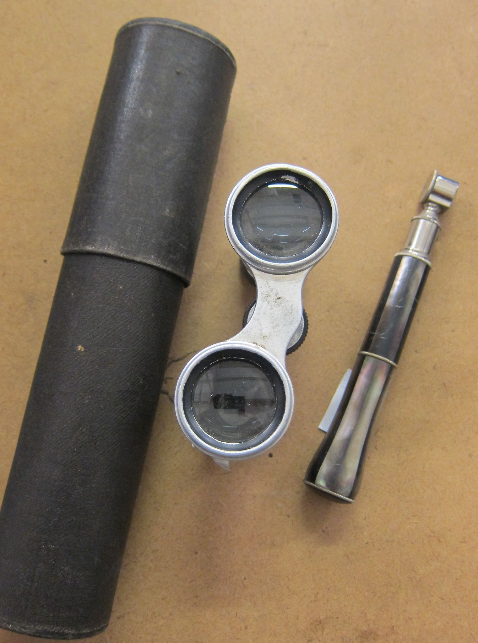A pair of opera glasses and a cased telescope (2)