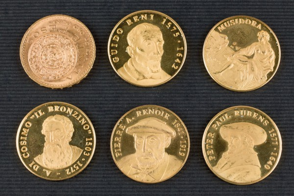 Five medals and a gold coin