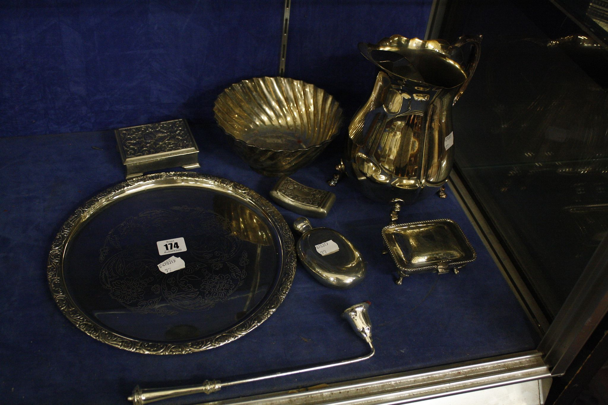 A quantity of silverplate , water jug, tray, bowl, candle snuff