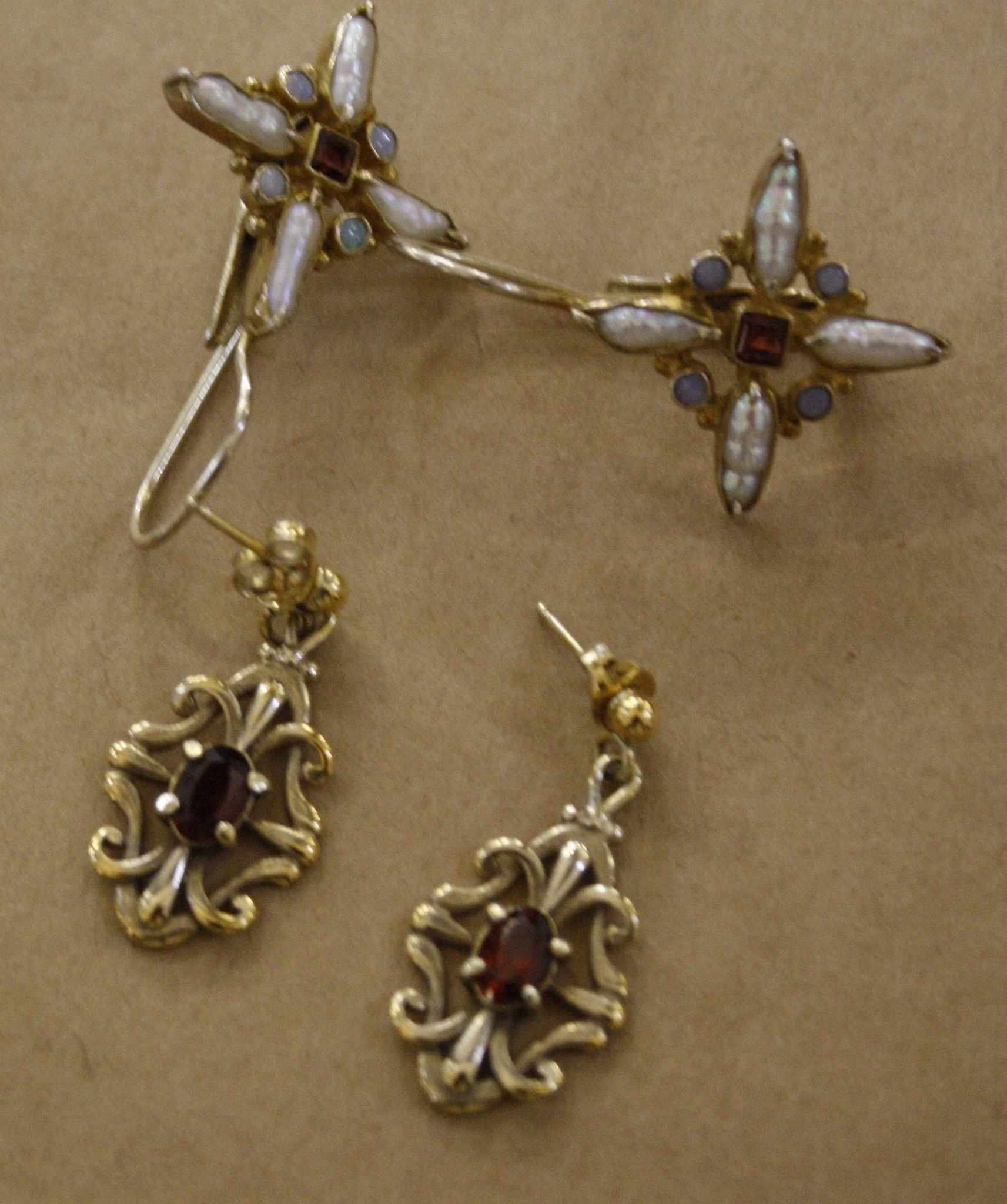 A pair of silver drop earrings