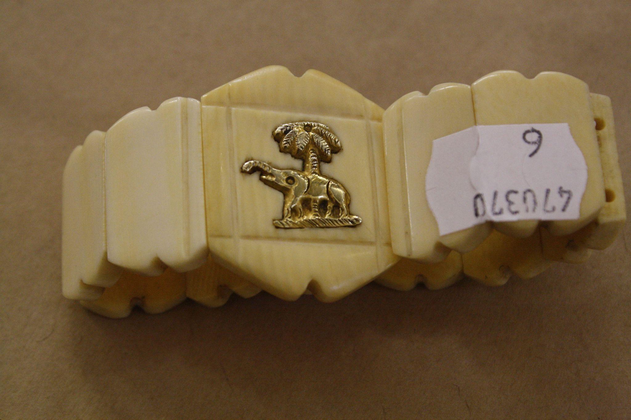 An ivory bracelet with inlaid elephant motif c.1920's