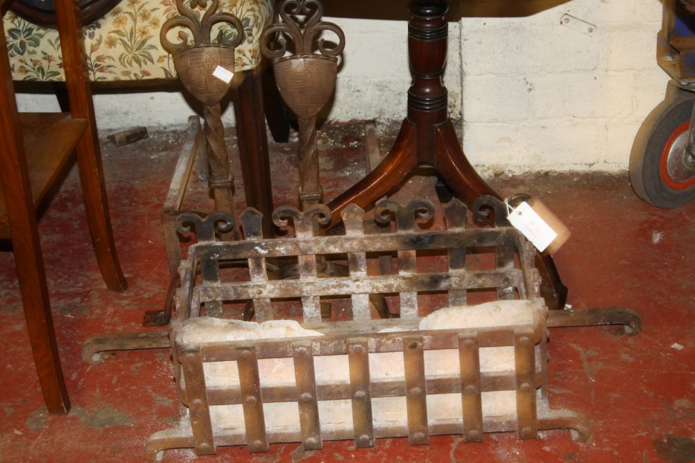 An iron firegrate and a pair of andirons