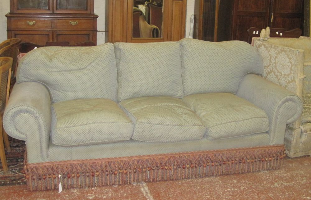 A large three-seat sofa green upholstered/red spots,