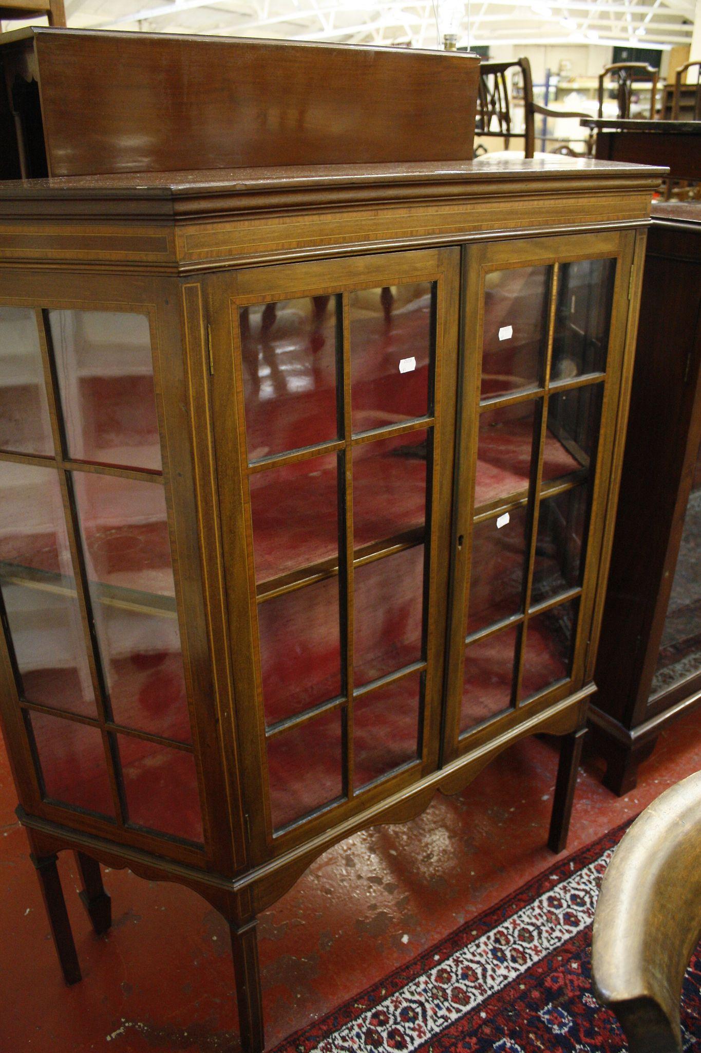 An Edwardian mahogany glazed china cabinet
