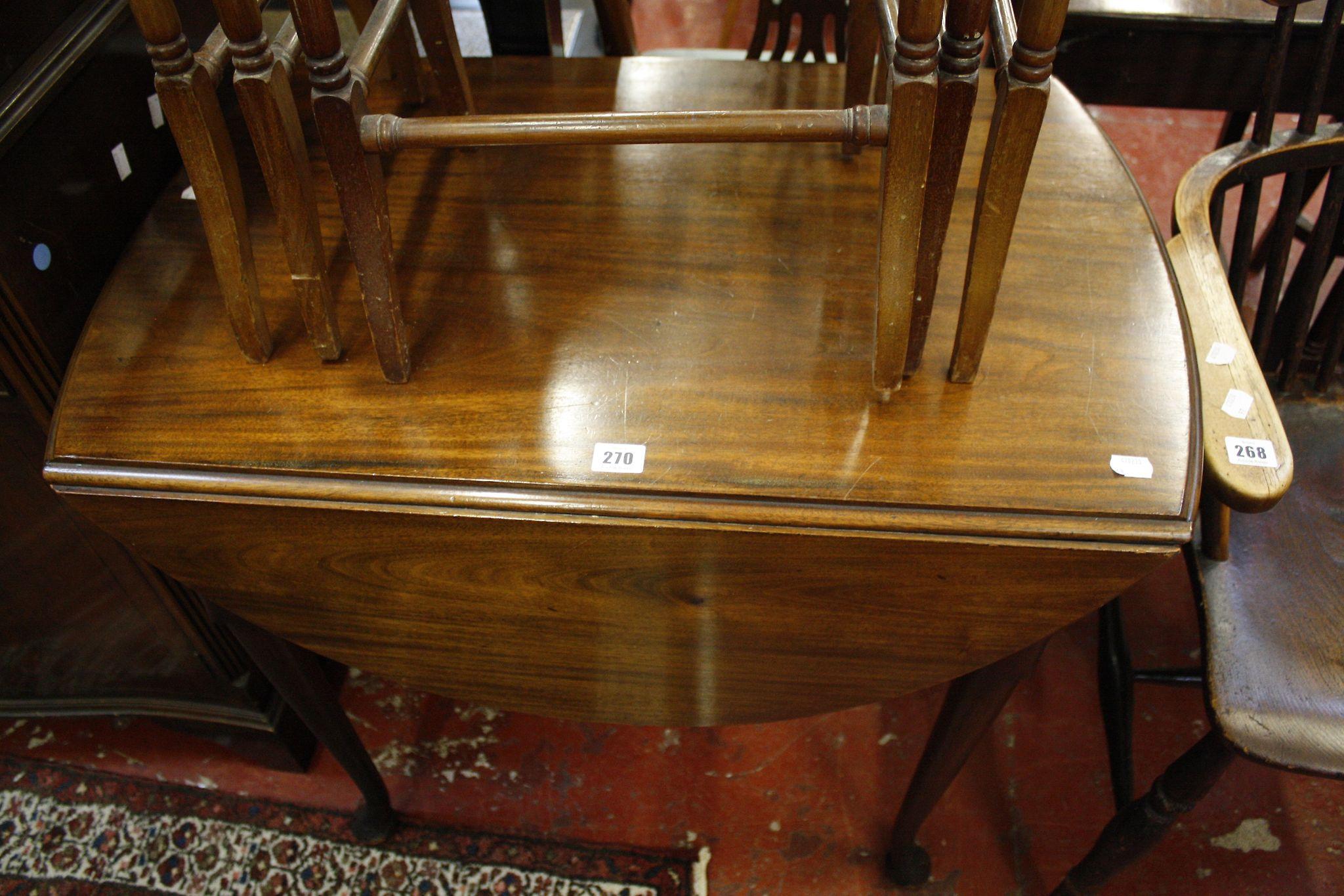 A Georgian style mahogany oval drop leaf table