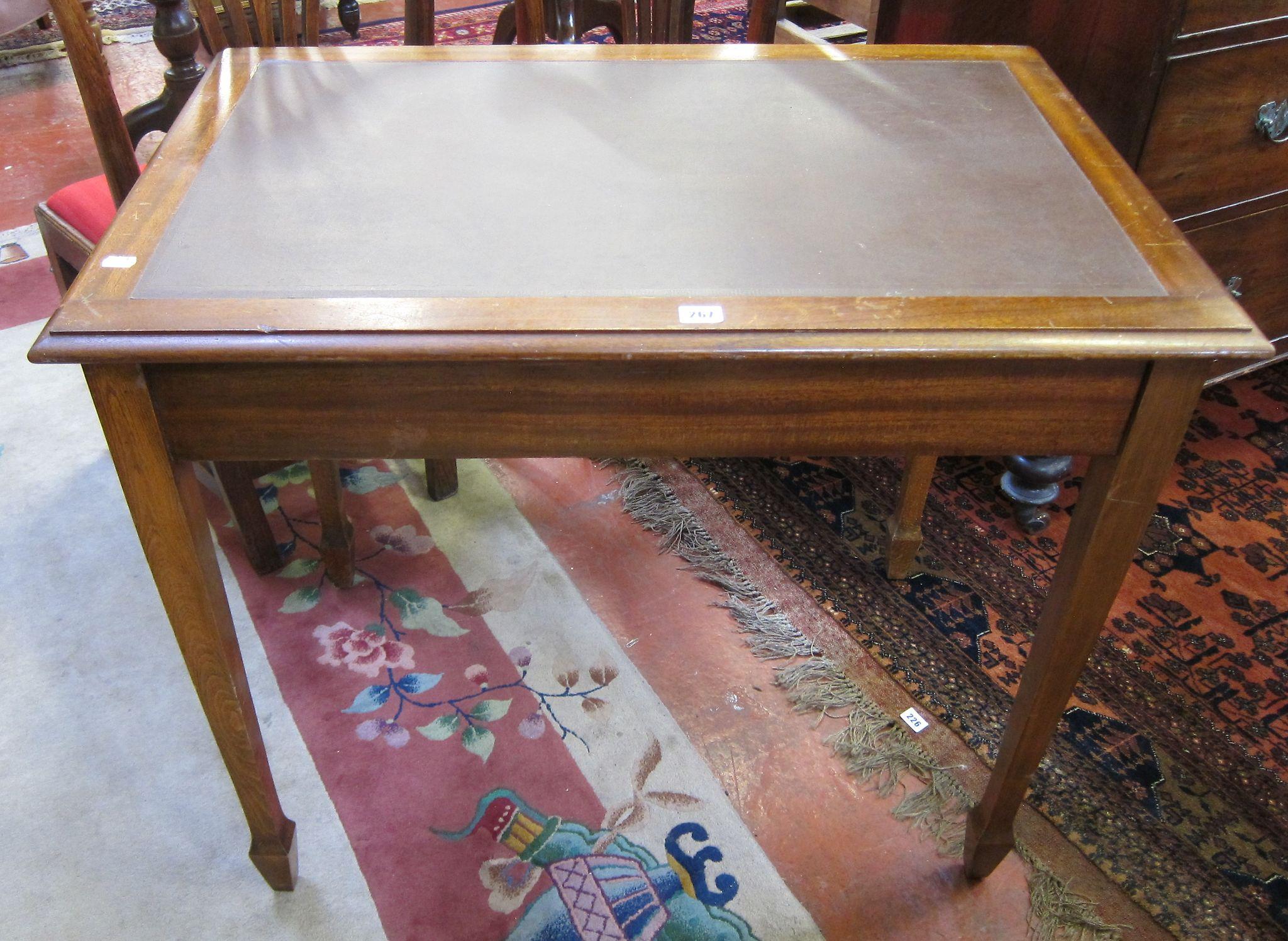 A mahogany office writing table