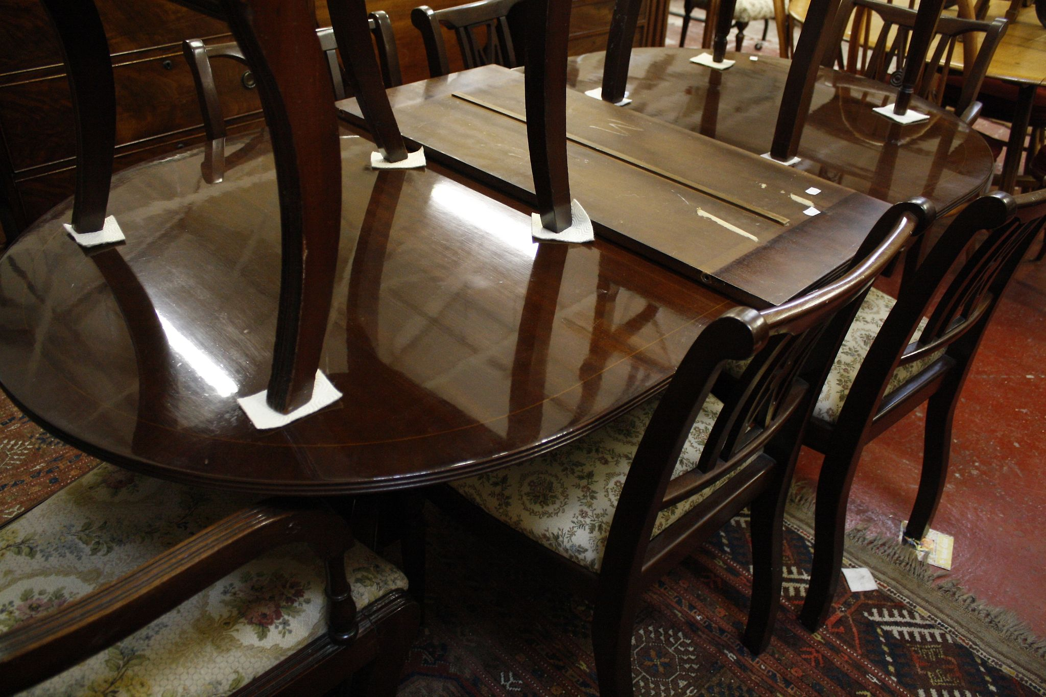 A Georgian style mahogany twin pedestal dining table