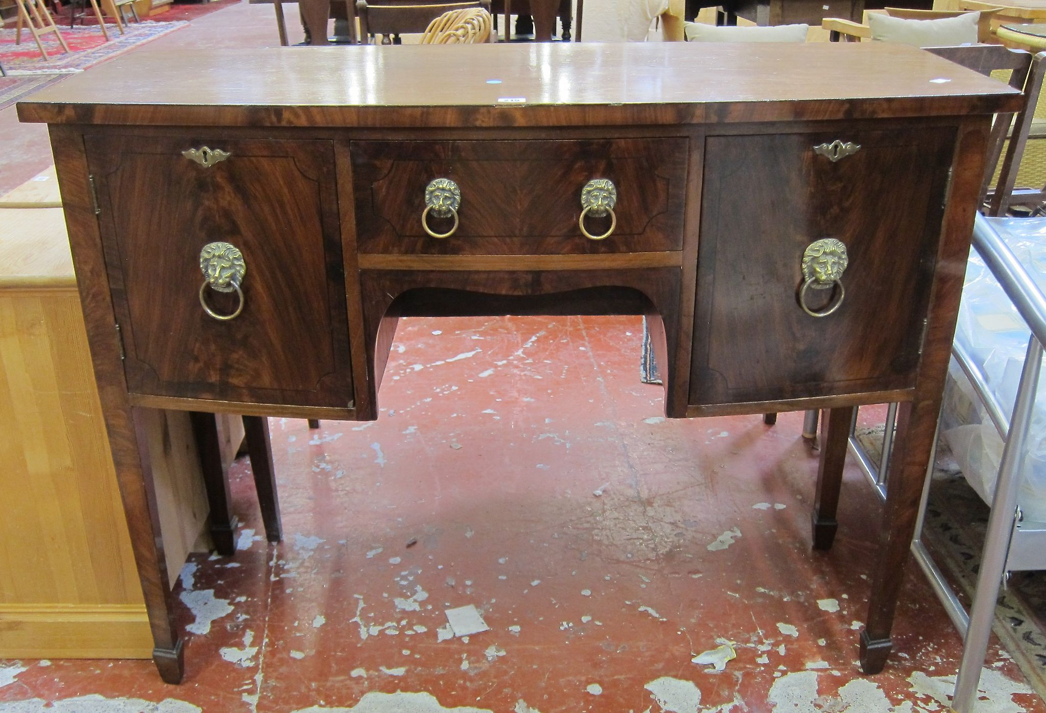 A Georgian style mahogany bow front sideboard