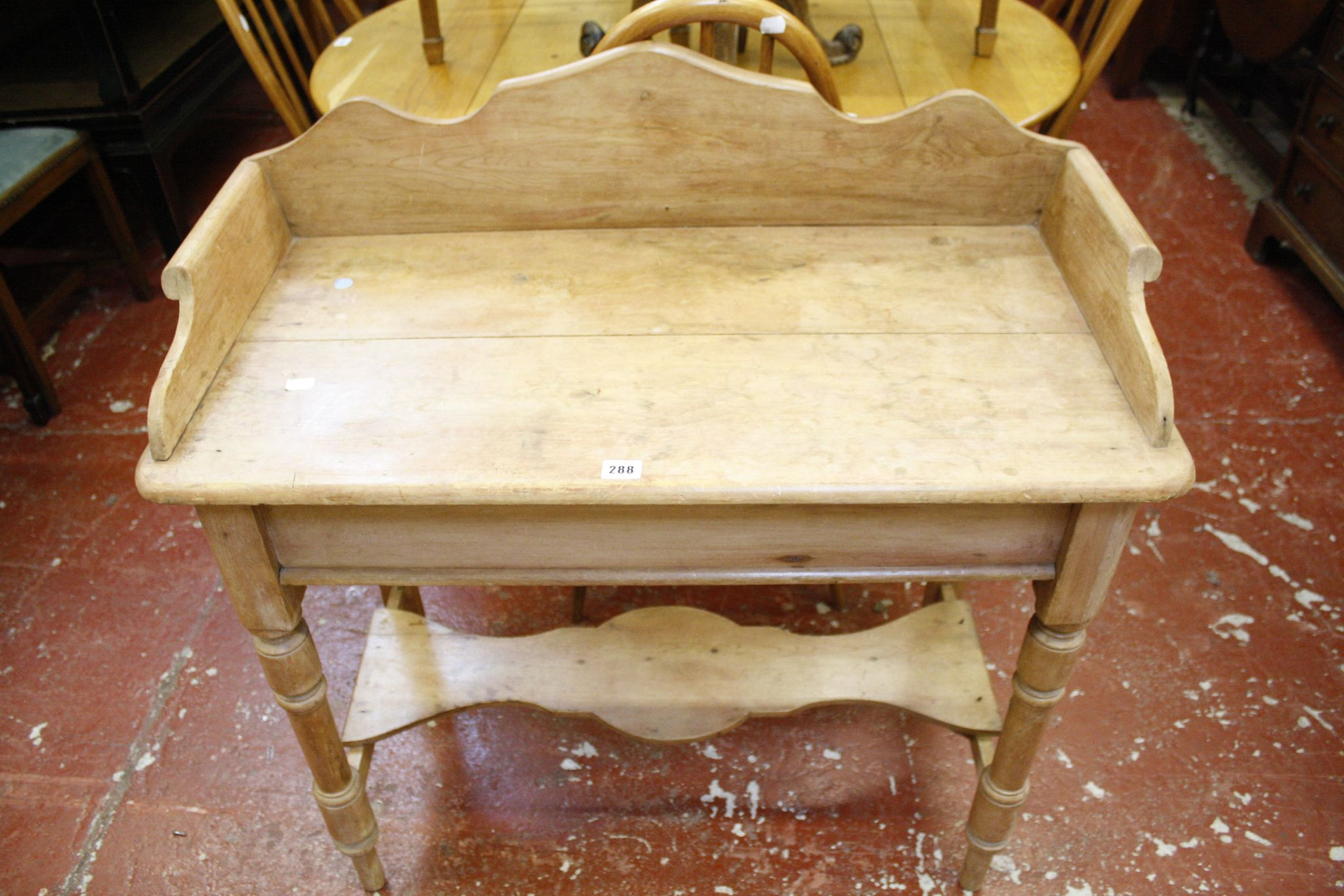 A Victorian pine galleried side table