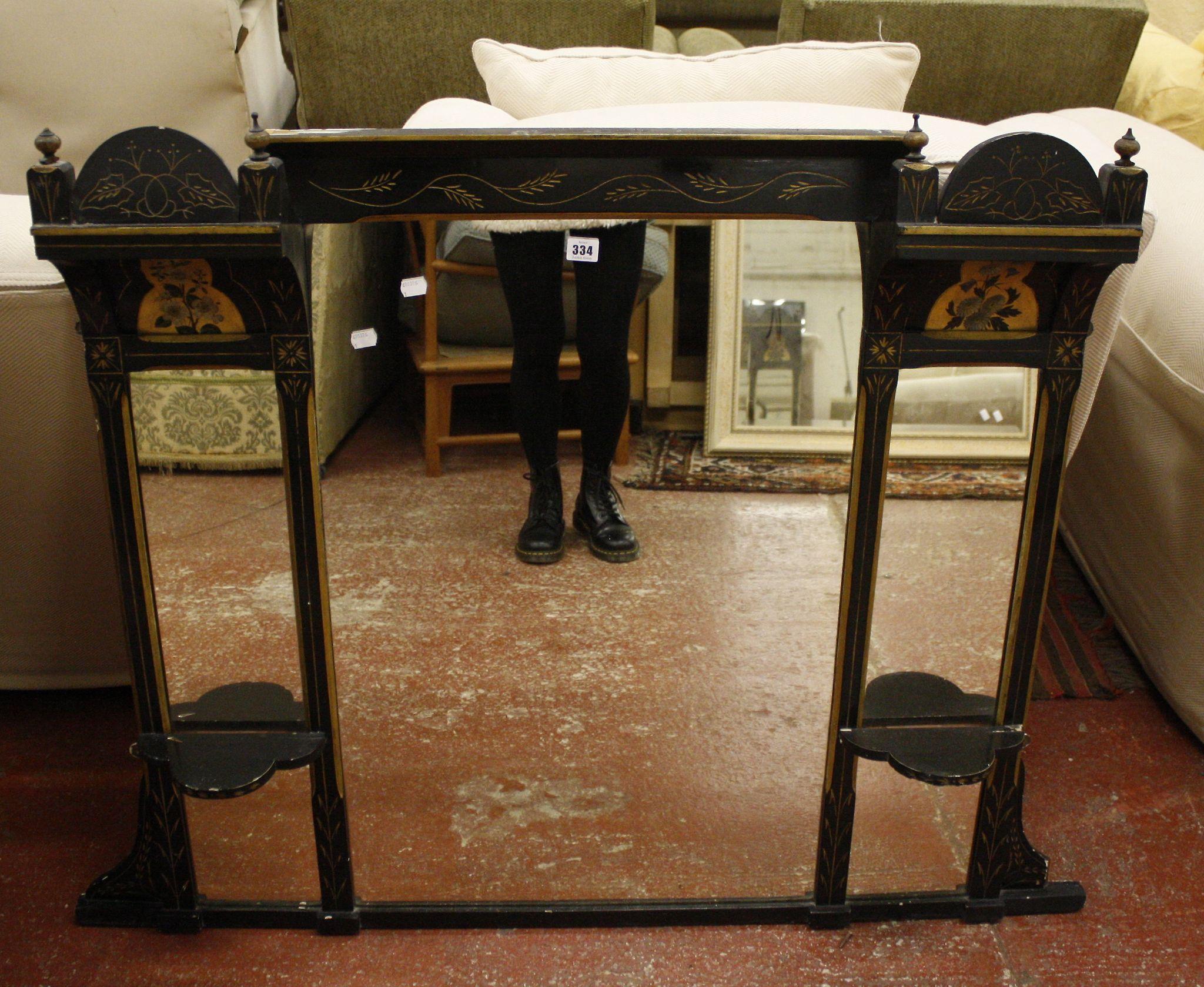 An ebonised overmantel Aesthetic mirror