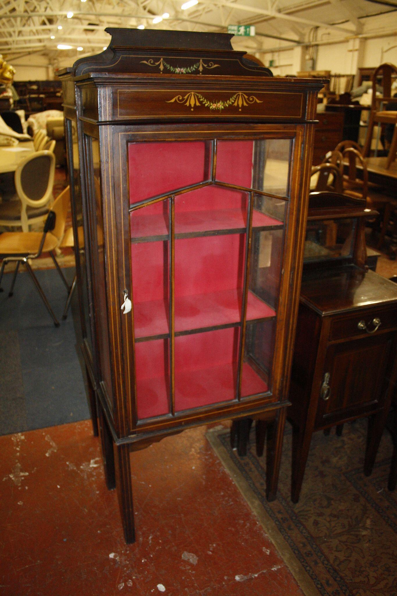 An Edwardian mahogany and line inlaid glazed cabinet