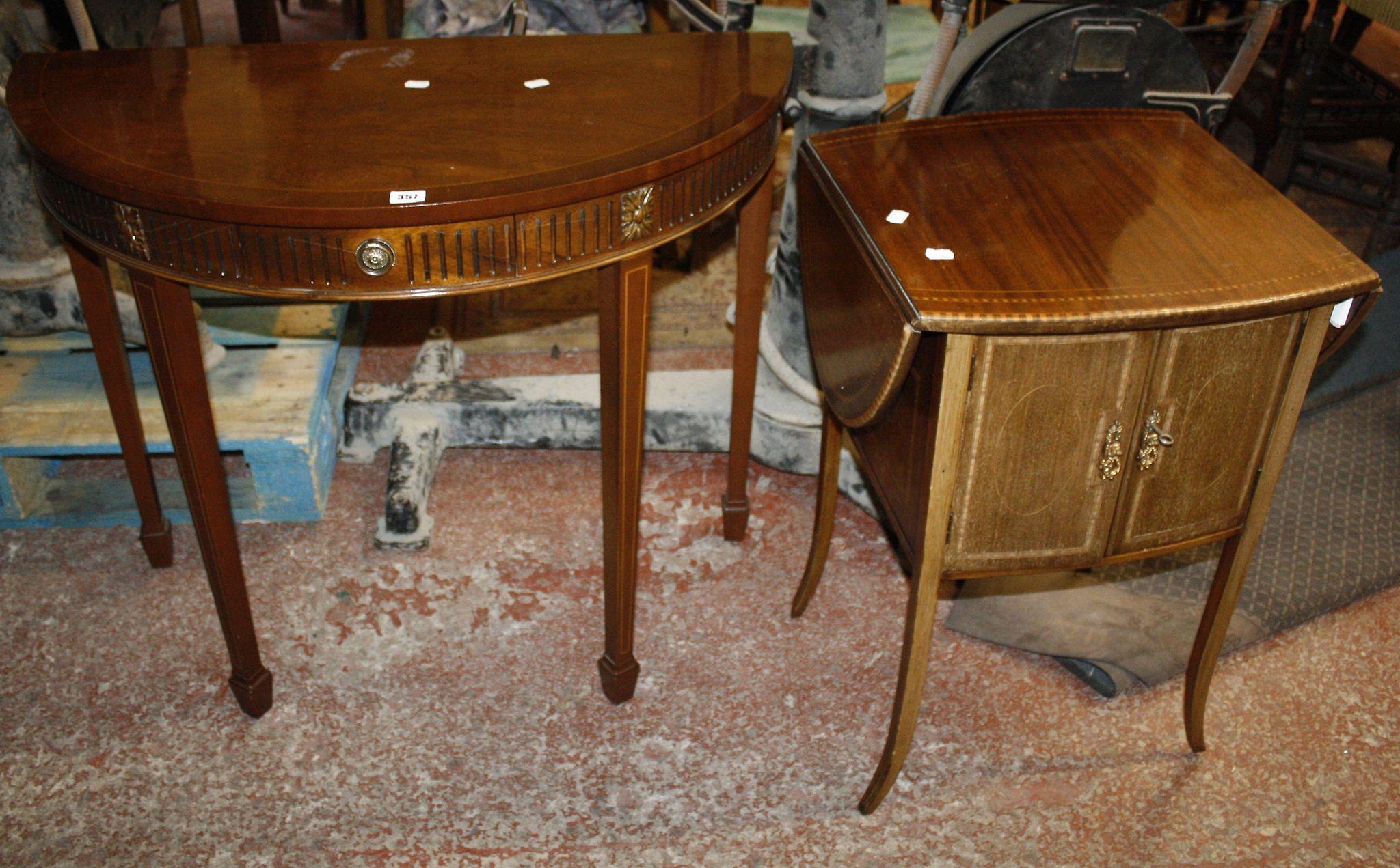 A mahogany demi lune hall table