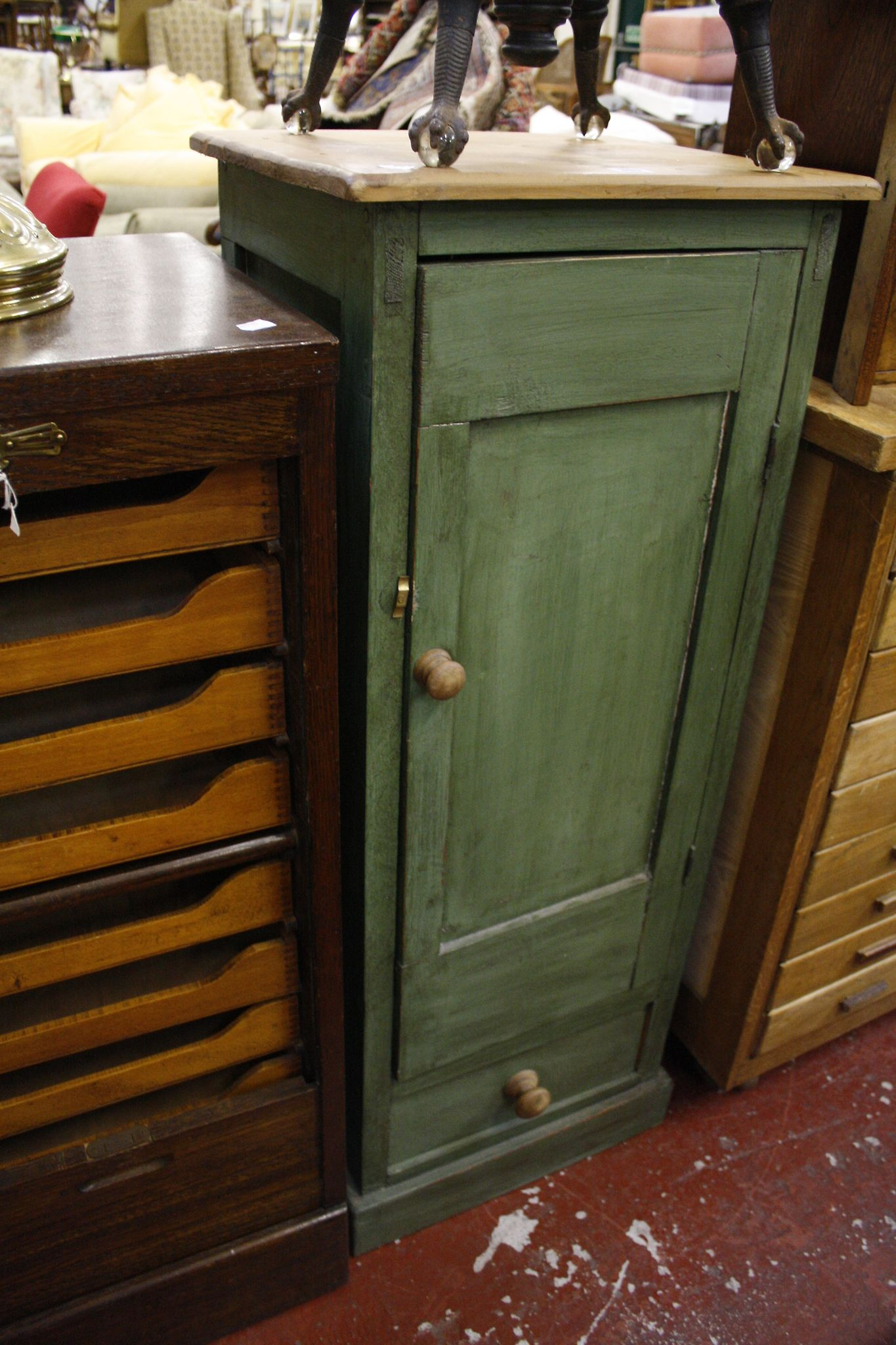 A narrow painted pine cupboard