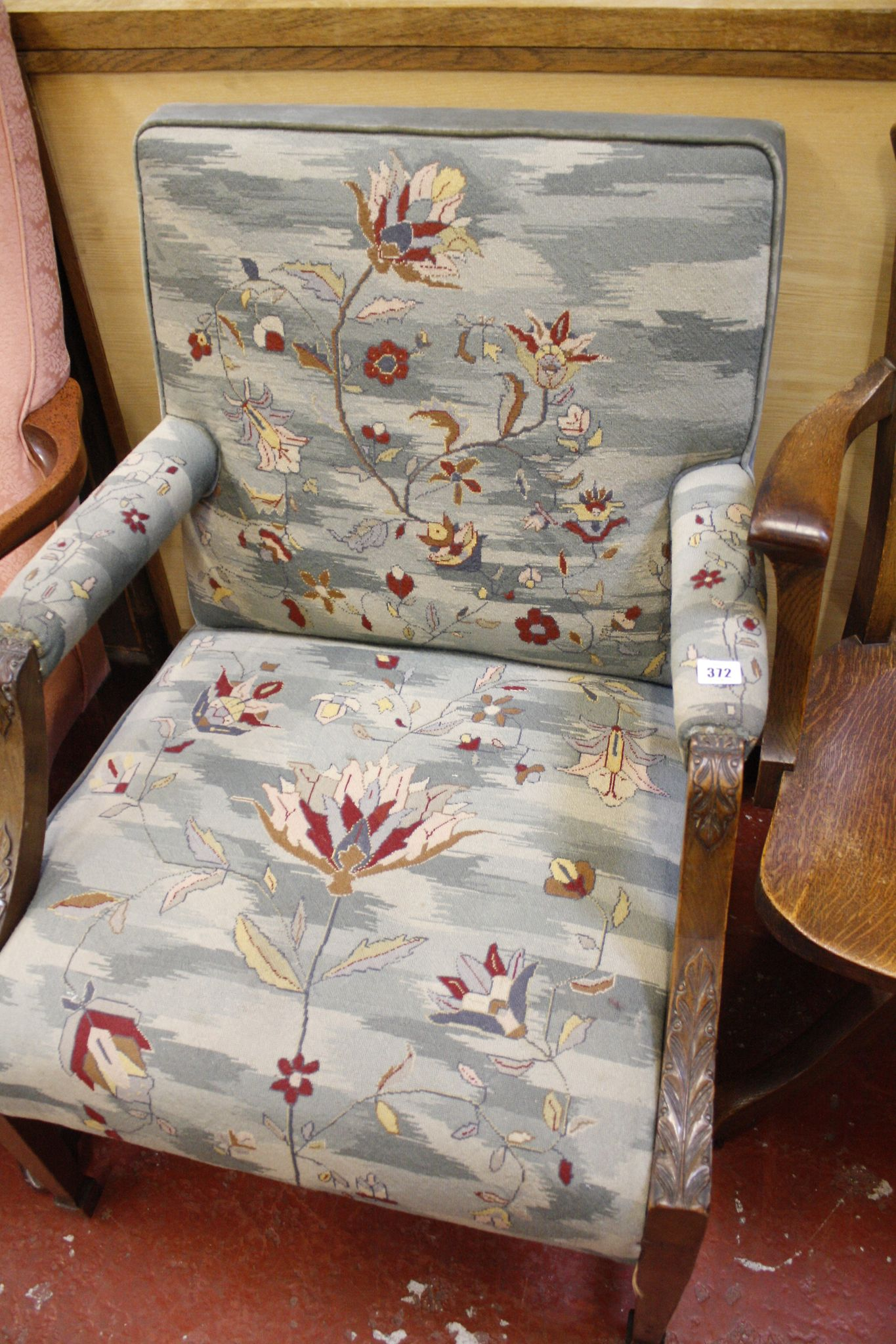 A mahogany Gainsborough style upholstered armchair