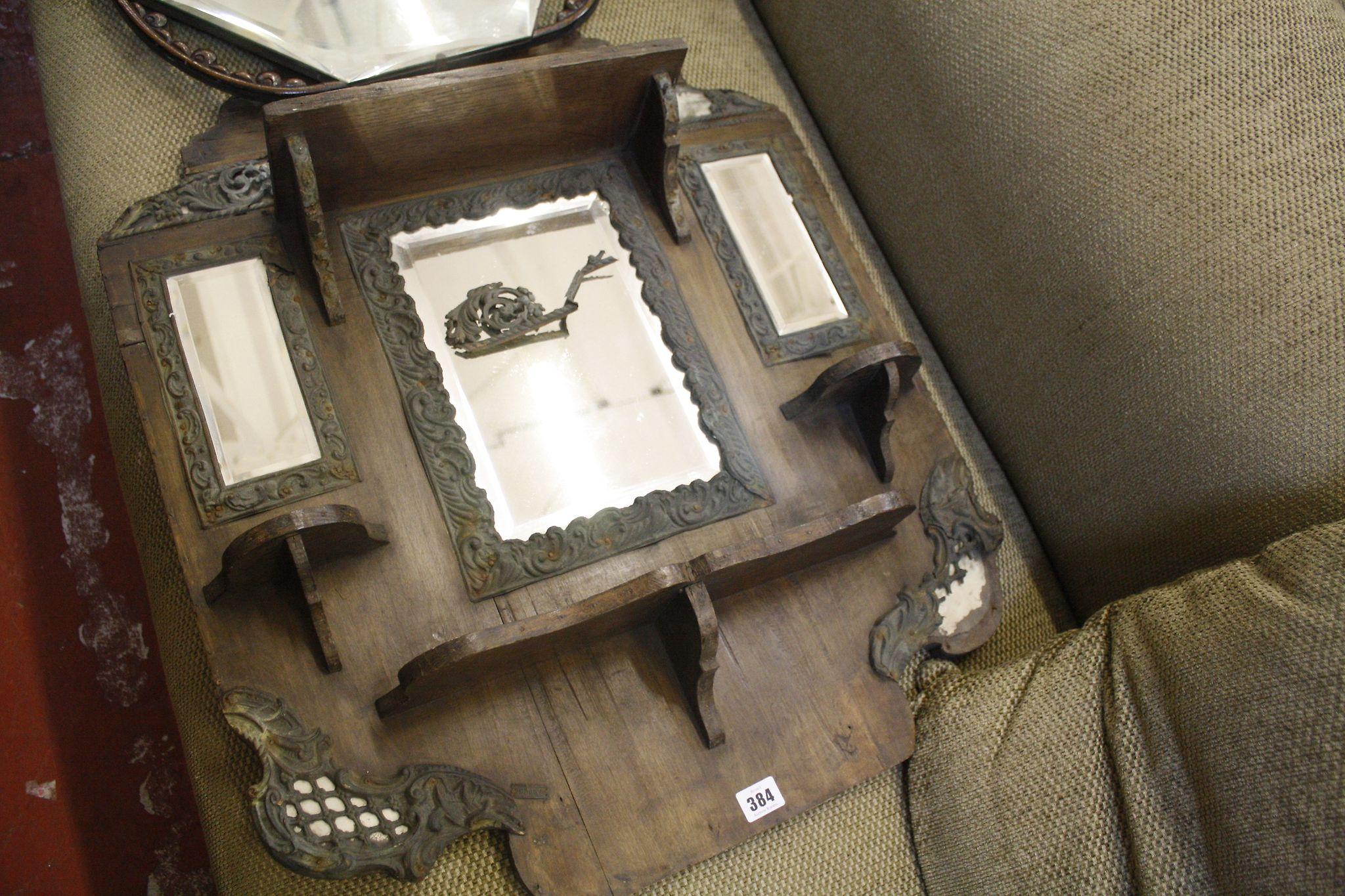 An oak framed hanging mirror