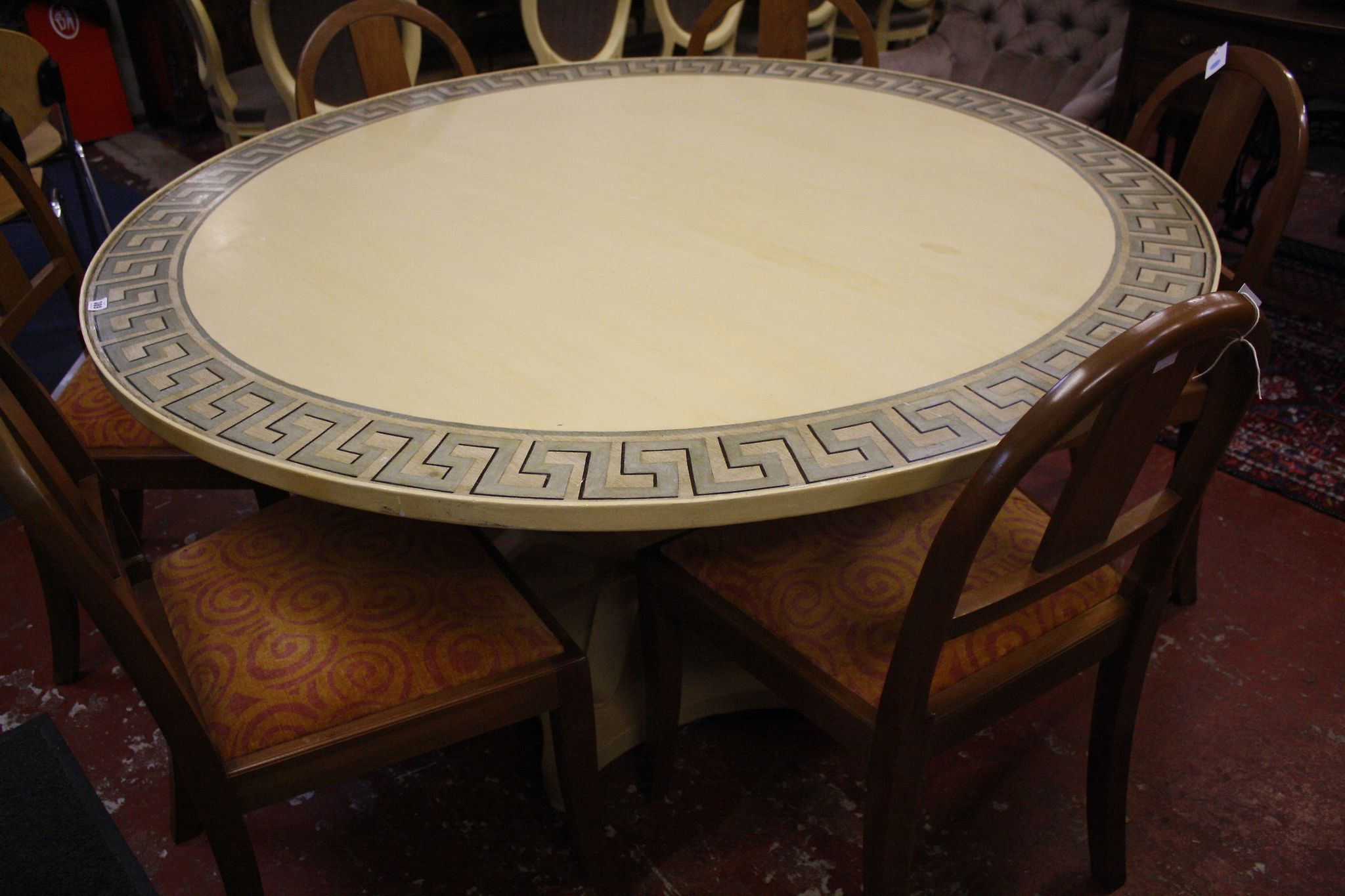 An ivory painted centre table