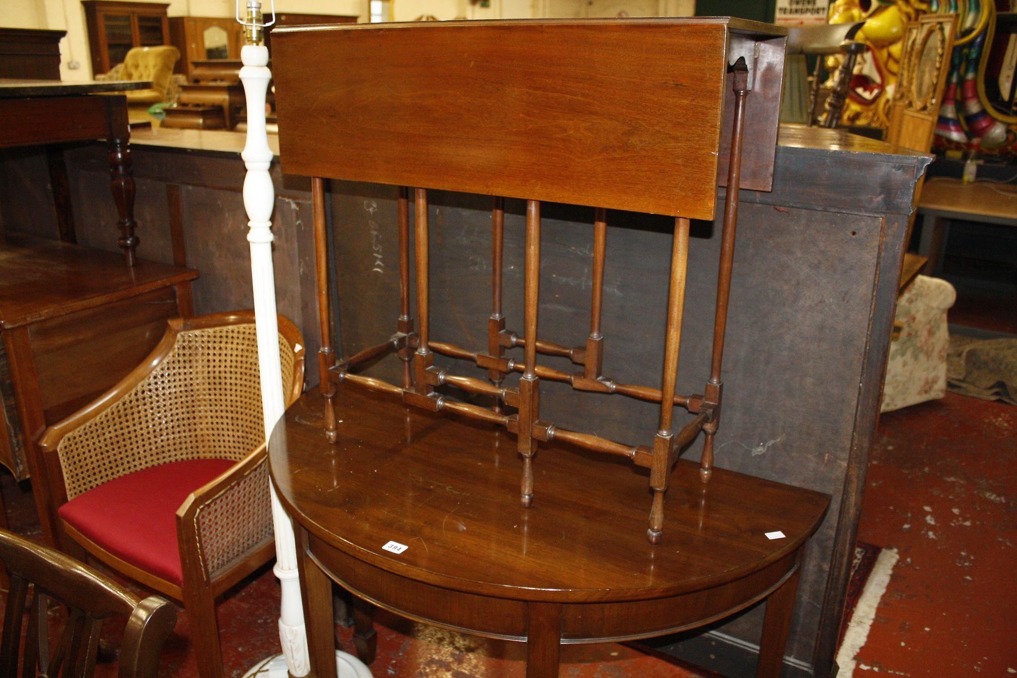 A mahogany spider leg table