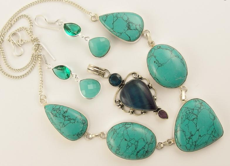 A silver banded fluorite pendant, a turquoise style necklace and a pair of silver gem set earrings