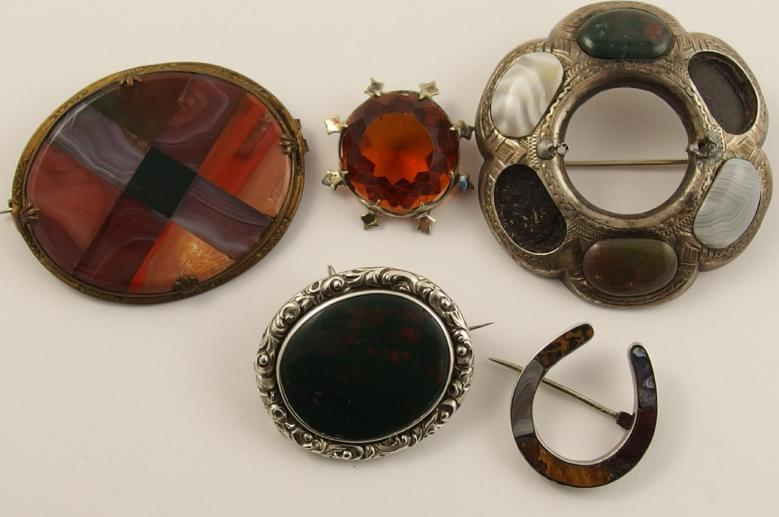 A collection of Scottish agate brooches and a further example set with bloodstone