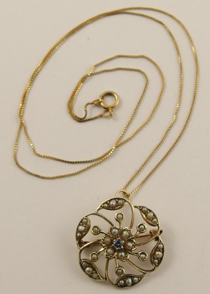 A 9ct Edwardian pendant brooch set with seed pearls and a blue gem stone, with a 9ct chain
