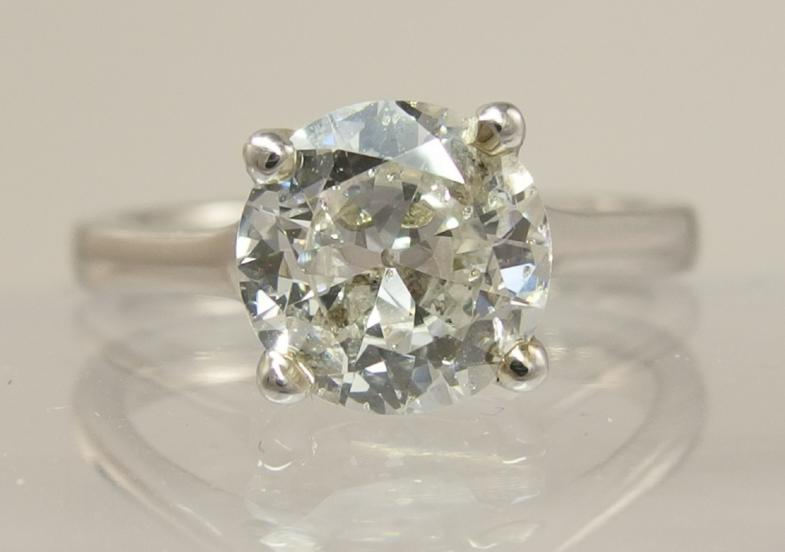 A platinum old cut diamond solitaire of 1.76ct with an IGI certificate which rates the diamond colour G
