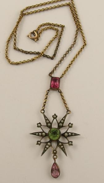 An Edwardian paste set white metal star pendant necklace