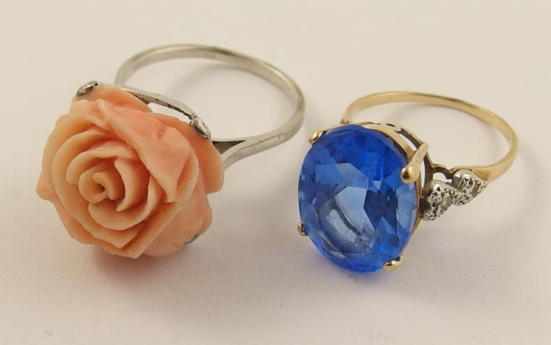 A French silver ring set with a carved coral rose, and a yellow metal blue gem ring with diamond shoulders