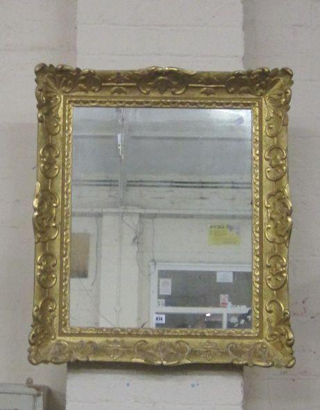 A giltwood framed wall mirror