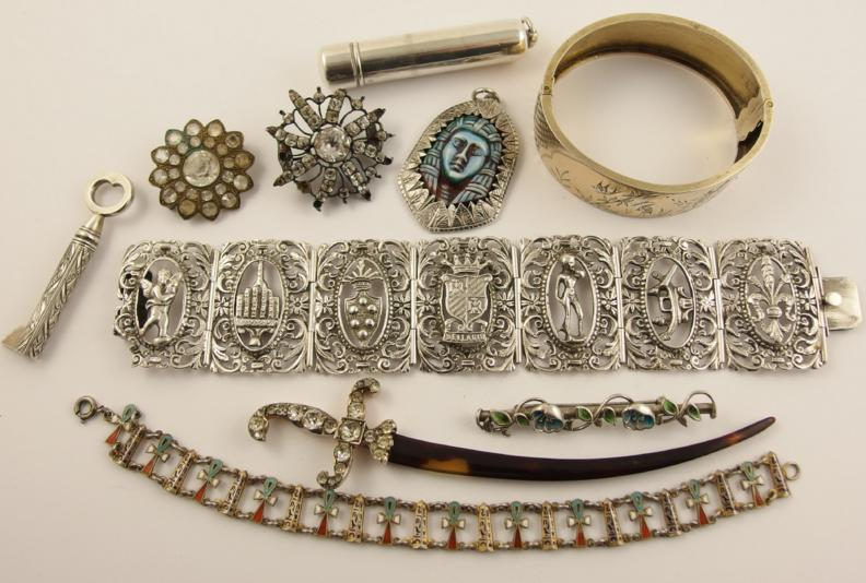 An Italian silver bracelet, from Bellagio, a Continental silver letter opener, two Egyptian revival pieces and other items