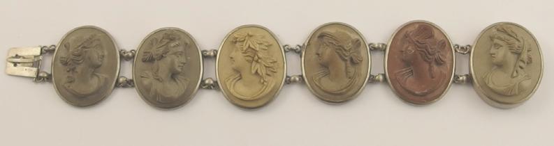 A white metal mounted lava style bracelet