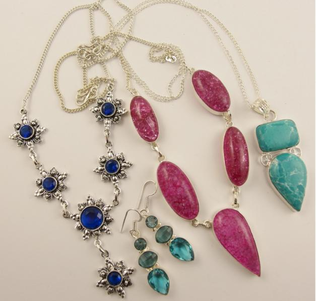 Three white metal statement necklaces set with brightly coloured gems and a pair of earrings