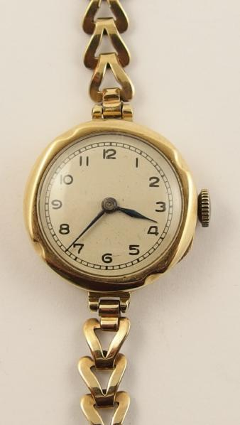 A ladies vintage 9ct Rolex Prima on a gold plated chain strap
