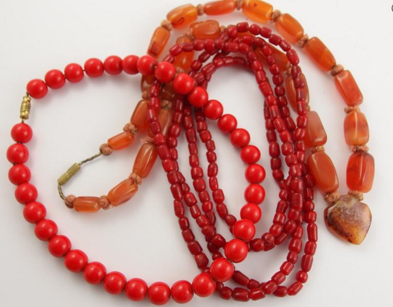 A string of carnelian beads and glass beads