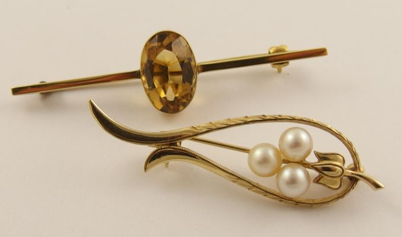 A 14ct gold and pearl brooch by Mikimoto together with a 9ct citrine set bar brooch